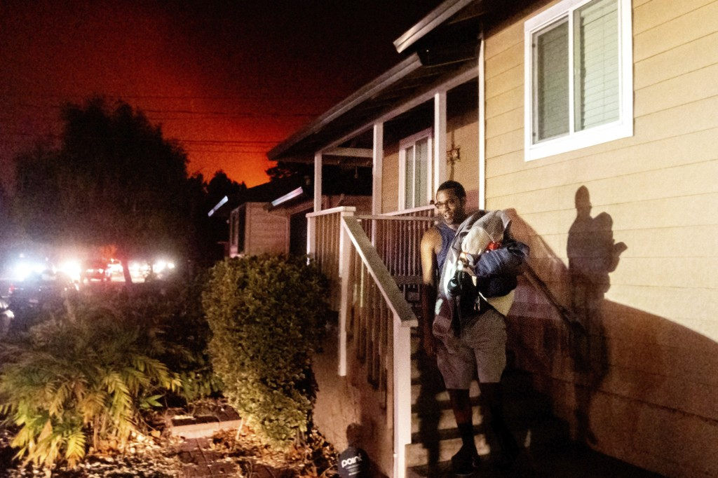 Eddy Whitmore evacuates from his Santa Rosa, Calif., home as the Shady Fire approaches on Sunday, Sept. 27, 2020. (AP Photo/Noah Berger)
