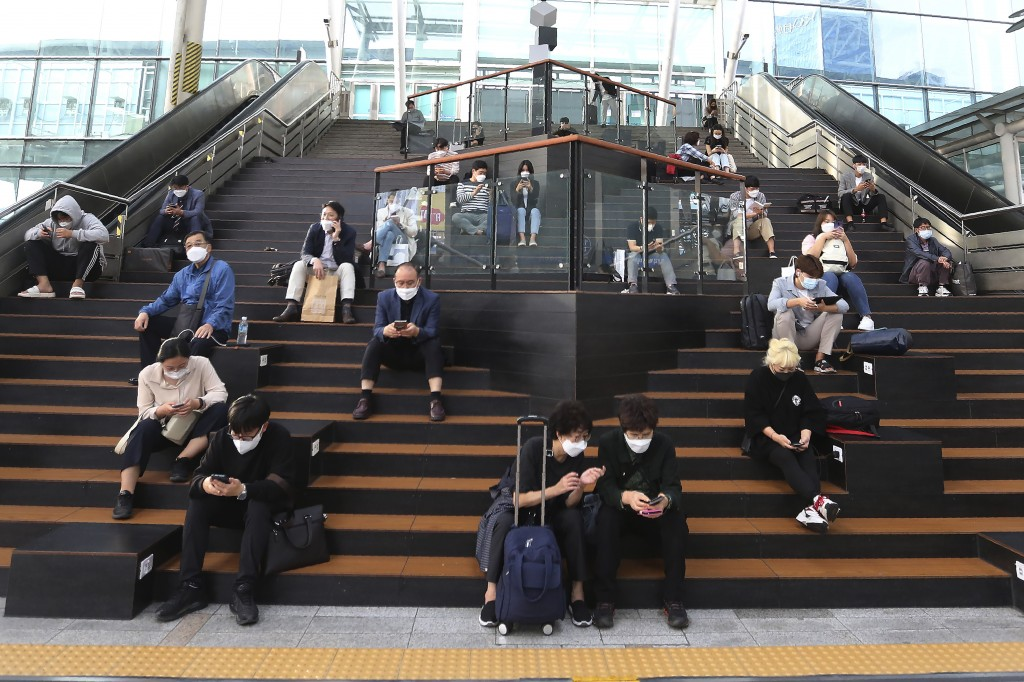 People wearing face masks to help protect against the spread of the coronavirus wait for their trains ahead of the upcoming Chuseok holiday, the Korea...