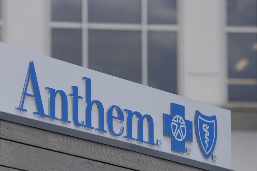 FILE - In this May 14, 2019, file photo signage on the outside of the corporate headquarters building of health insurance company Anthem is shown in I...