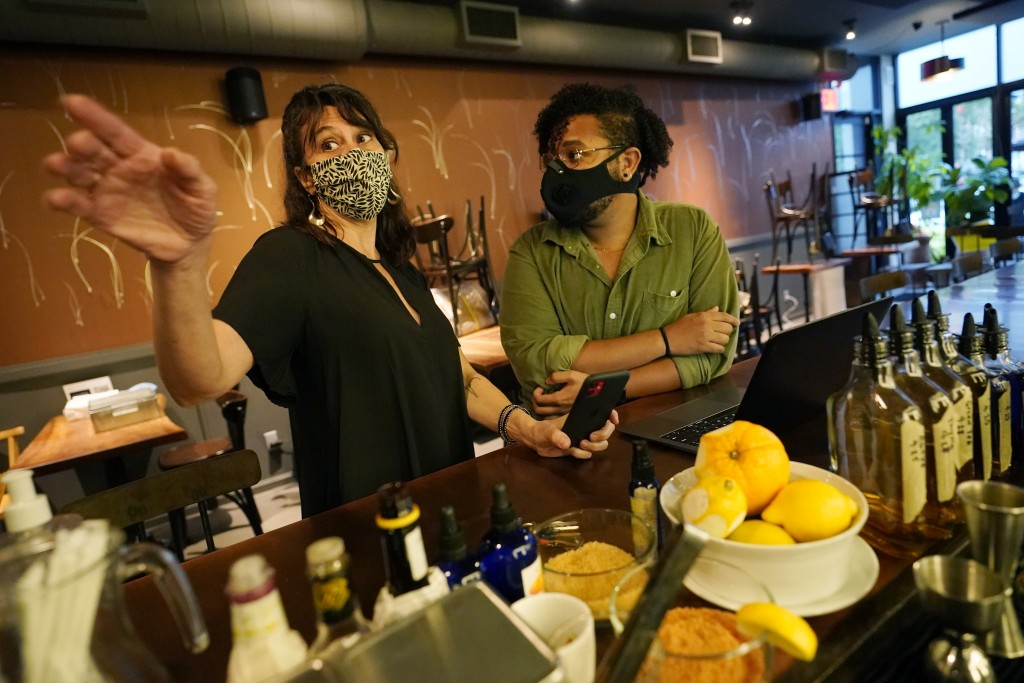 Mama Fox bar and restaurant owner Samantha DiStefano, left, talks about indoor dining reopening plans with manager Akin Payne, Tuesday, Sept. 29, 2020...