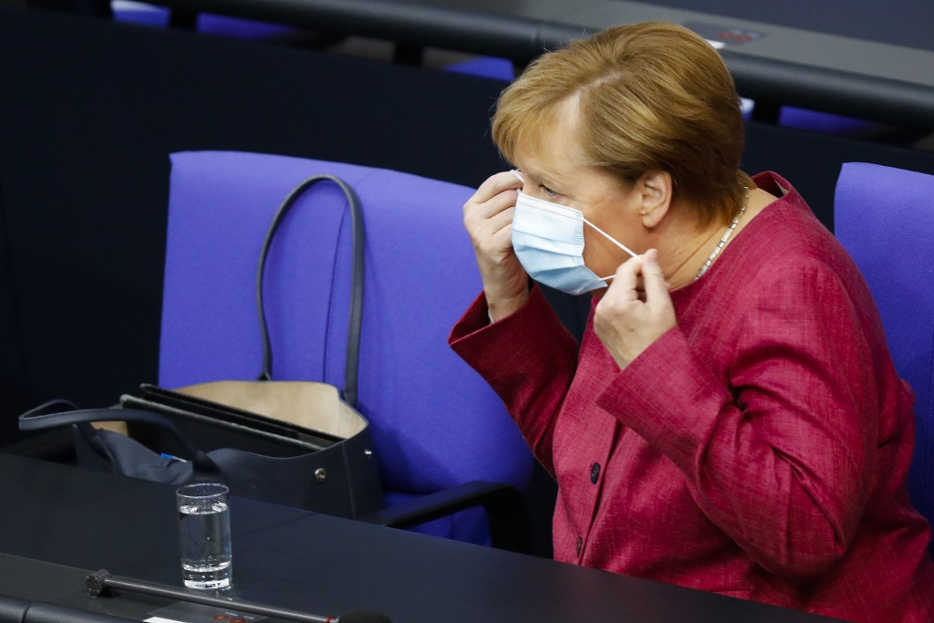 German Chancellor Angela Merkel arrives for a debate about her policy as part of Germany's budget 2021 debate at the parliament Bundestag in Berlin, G...
