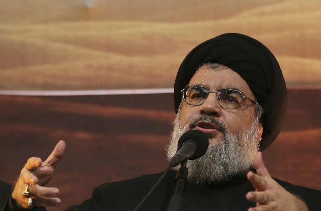 FILE - In this Nov. 3, 2014 file photo, Hezbollah leader Hassan Nasrallah addresses supporters in the southern suburb of Beirut, Lebanon. The Hezbolla...