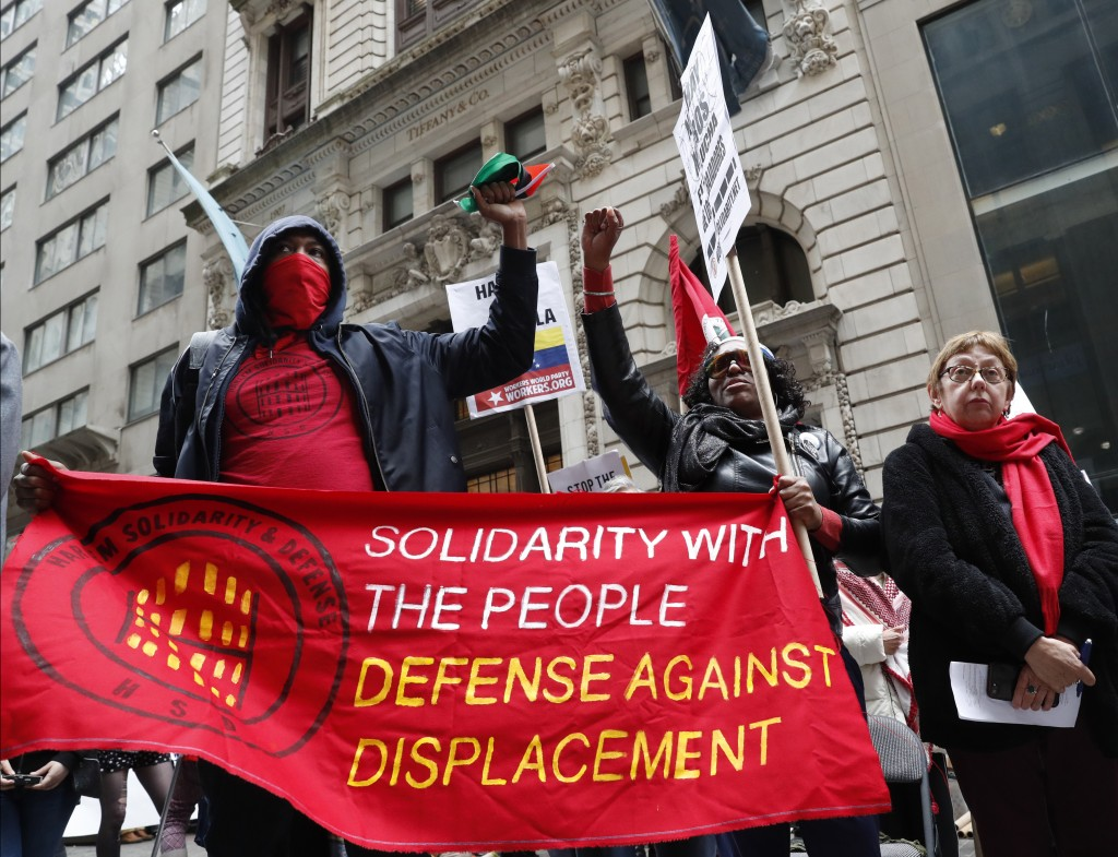 FILE  - In this Wednesday, May 1, 2019 file photo, people from Harlem Solidarity and Defense, protesting displacement from gentrification of their nei...
