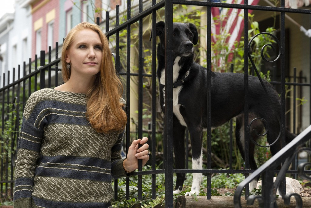 American Airlines flight attendant Allie Malis stands outside her home with her dog Piper on Friday, Sept. 25, 2020 in Washington. About 40,000 worker...