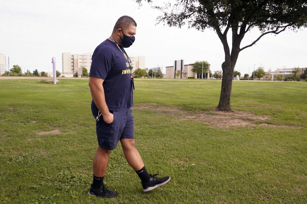 Tevita Uhatafe takes a step as he talks about his job and family, Monday, Sept. 28, 2020, in Grapevine, Texas. Uhatafe was working 60 hours a week bef...