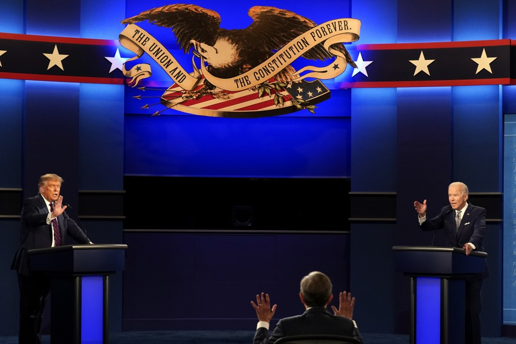 Moderator Chris Wallace of Fox News as well as President Donald Trump and Democratic candidate former Vice President Joe Biden during the first presid...