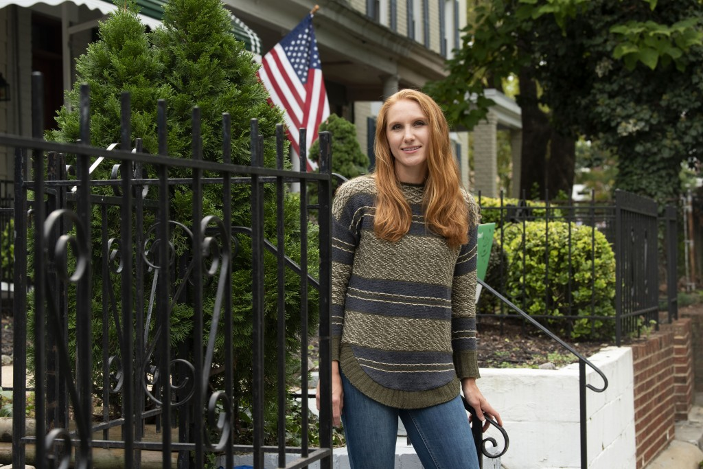 American Airlines flight attendant Allie Malis stands outside her home on Friday, Sept. 25, 2020, in Washington. About 40,000 workers in the airline i...