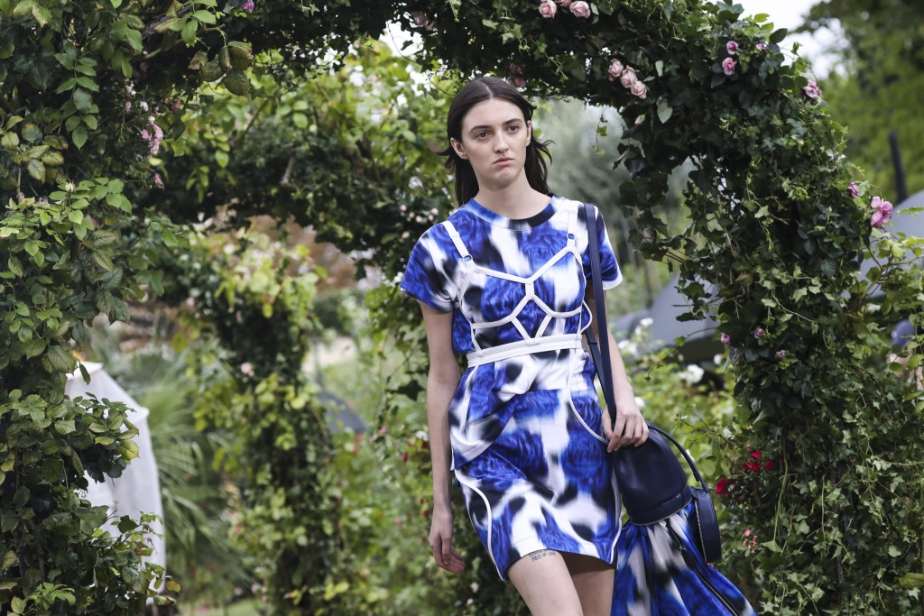 A model wears a creation for the Kenzo Spring-Summer 2021 fashion collection, Wednesday, Sept. 30, 2020, during Paris fashion week. (Photo by Vianney ...