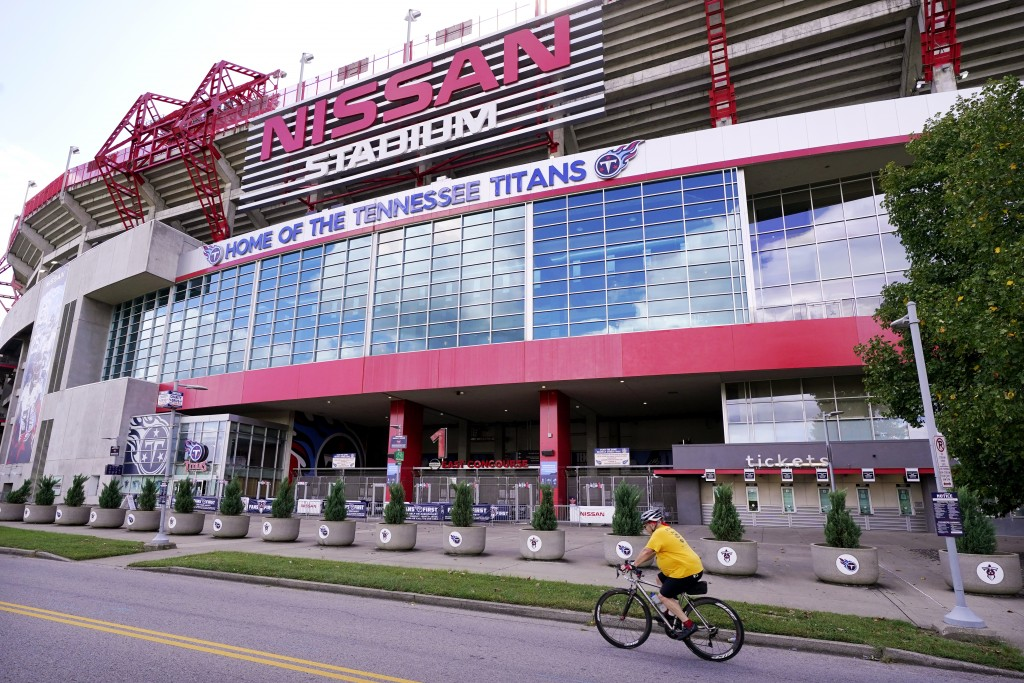A cyclist passes by Nissan Stadium, home of the Tennessee Titans, Tuesday, Sept. 29, 2020, in Nashville, Tenn. The Titans suspended in-person activiti...