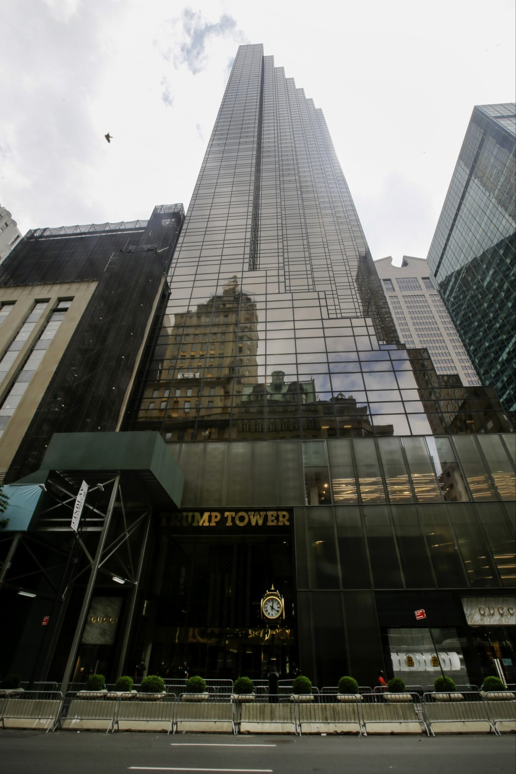 FILE - In this Tuesday, July 7, 2020 file photo, pedestrians walk past the Trump Tower building in New York. Trump's true financial picture has gotten...