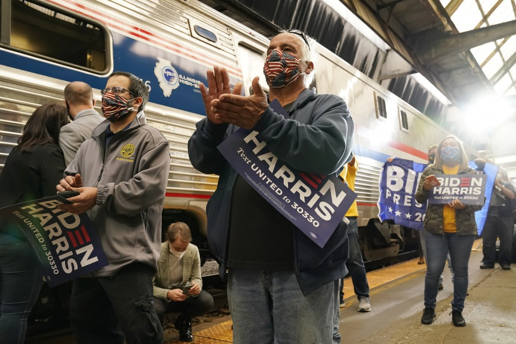 Supporters applaud as Democratic presidential candidate former Vice President Joe Biden speaks at Amtrak's Pittsburgh Train Station, Wednesday, Sept. ...
