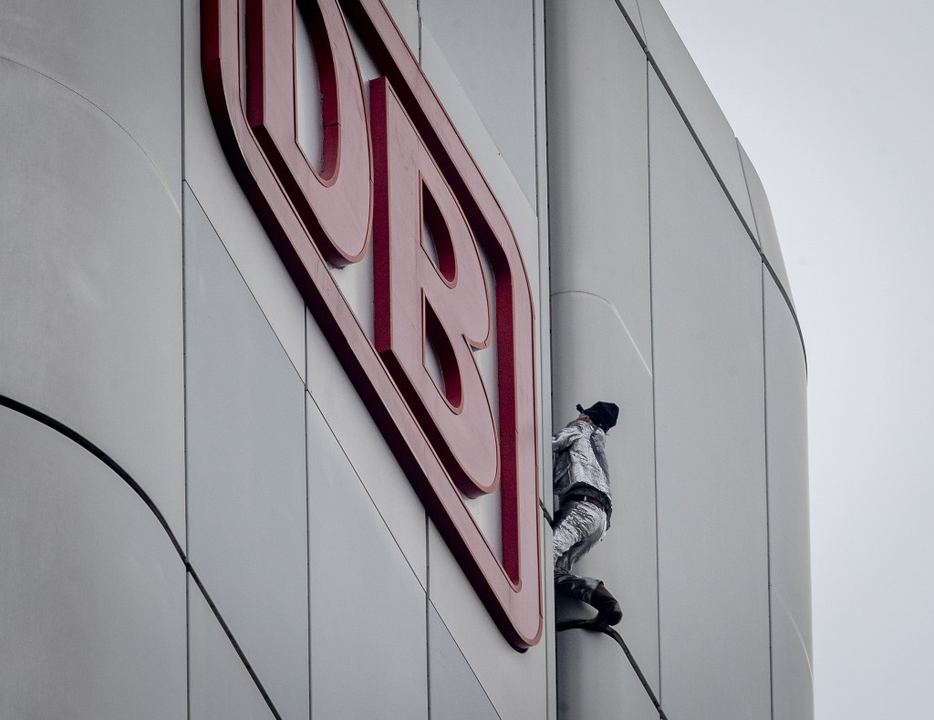 """French urban climber Alain Robert, well known as """"Spiderman"""", climbs up the Deutsche Bahn high-rise in central Frankfurt, Germany, Thursday, Oct. 1, 2..."""