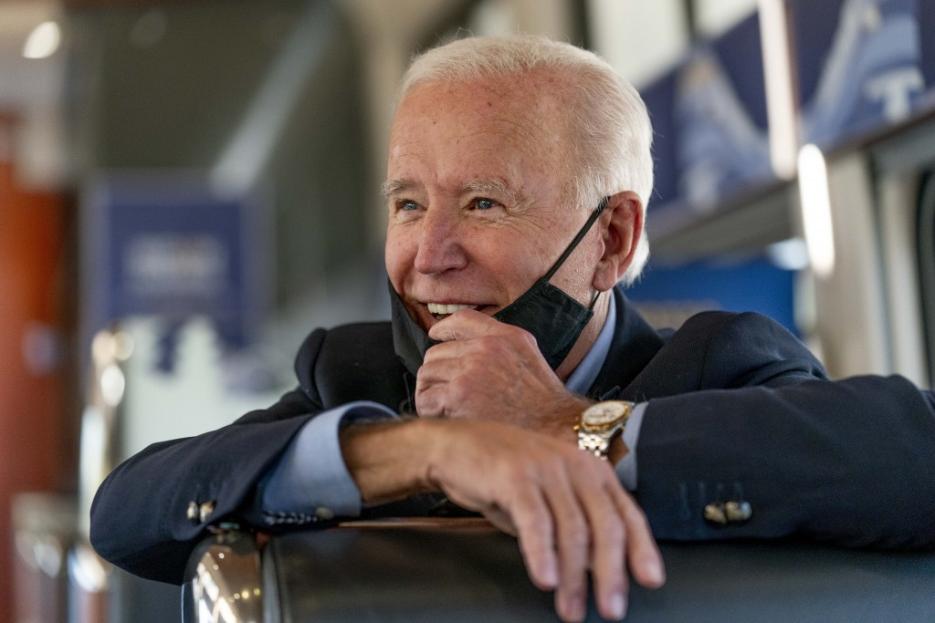 Democratic presidential candidate former Vice President Joe Biden speaks with United Steelworkers Union President Thomas Conway and school teacher Den...