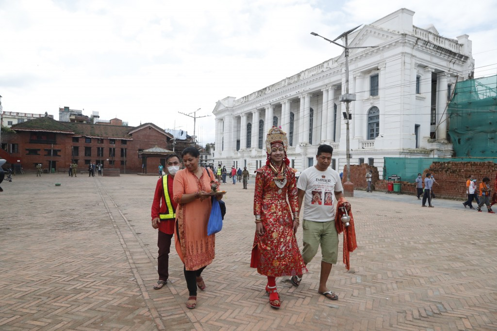 Living God Bhairav, center, walks back home after a ritual was performed during Indrajatra festival as the festival was canceled to control the spread...