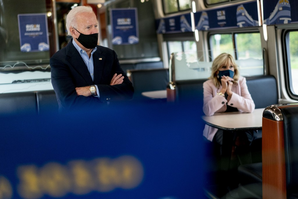 Democratic presidential candidate former Vice President Joe Biden and his wife Jill Biden, right, speak with invited guests aboard an Amtrak train, We...