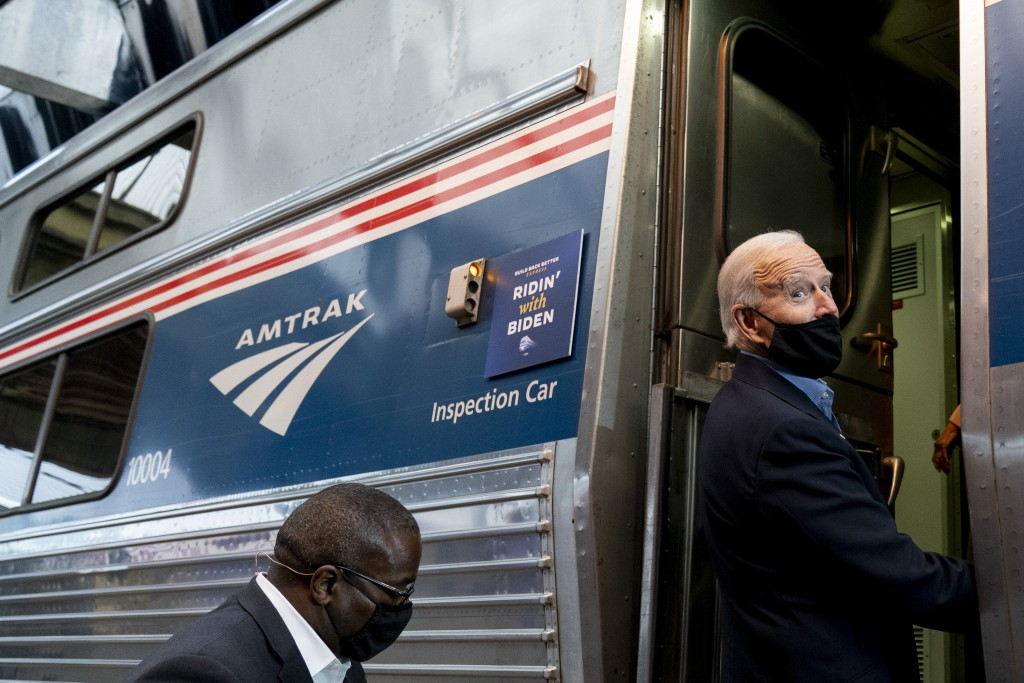 Democratic presidential candidate former Vice President Joe Biden boards his train at Amtrak's Pittsburgh Train Station, Wednesday, Sept. 30, 2020, in...