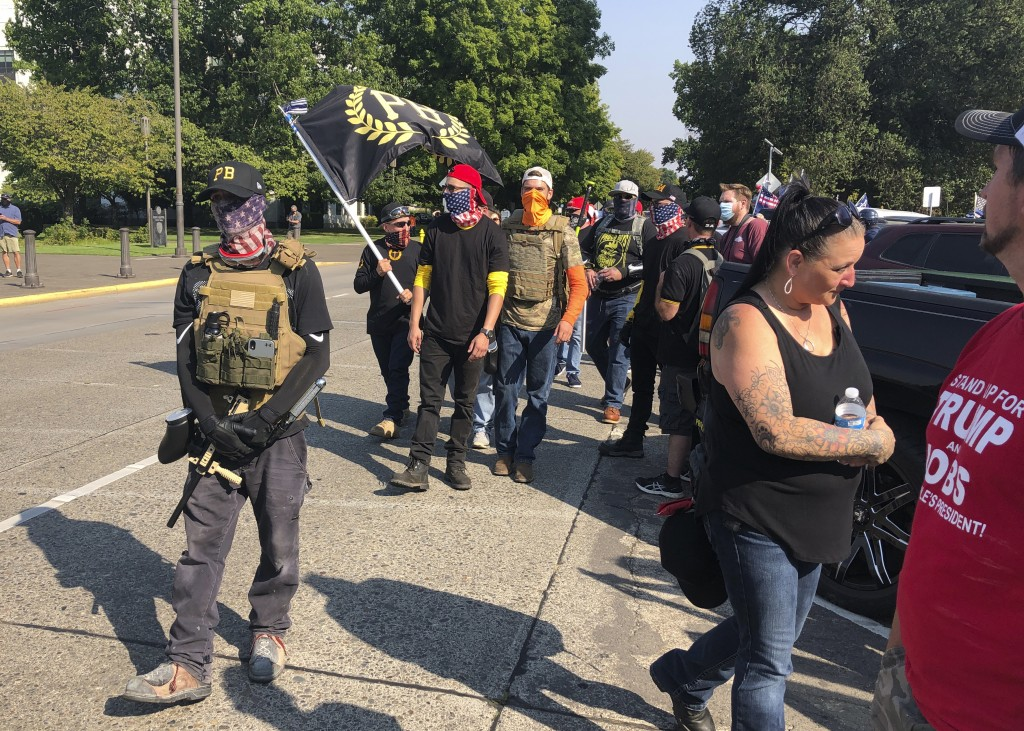 FILE - Members of the extremist right-wing group the Proud Boys arrive in Salem, Ore., on Monday Sept. 7, 2020 for a pro-Donald Trump rally at the Cap...