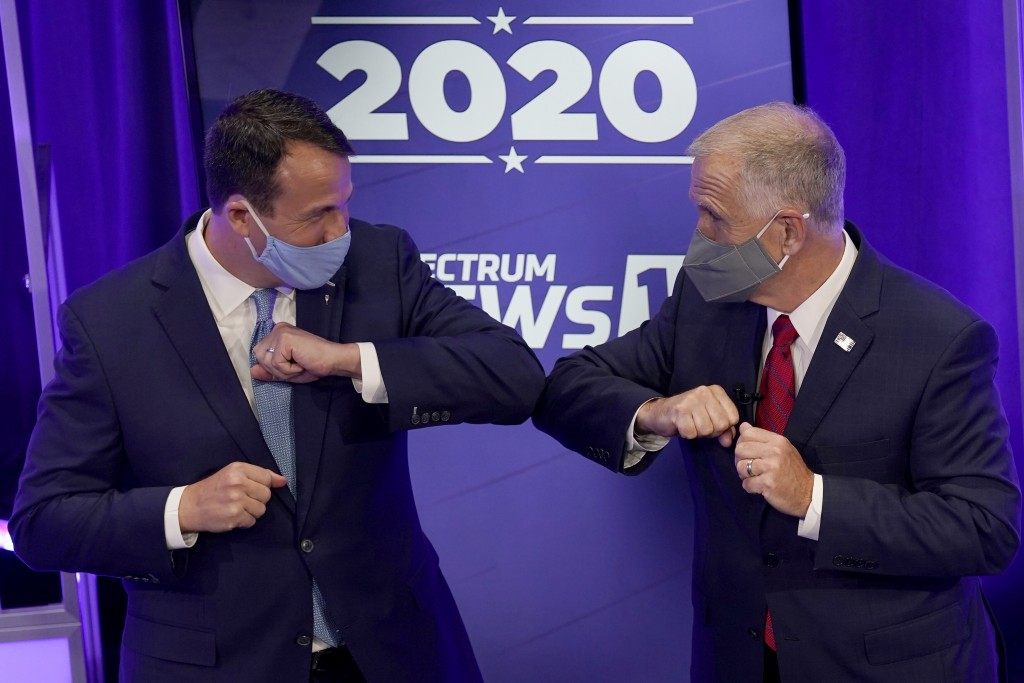 Democratic challenger Cal Cunningham, left, and U.S. Sen. Thom Tillis, R-N.C. greet each other after a televised debate Thursday, Oct. 1, 2020, in Ral...