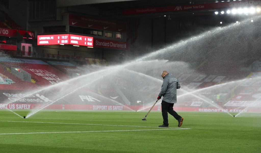A groundsman works on the pitch ahead of the English League Cup fourth round soccer match between Liverpool and Arsenal at Anfield, Liverpool, England...