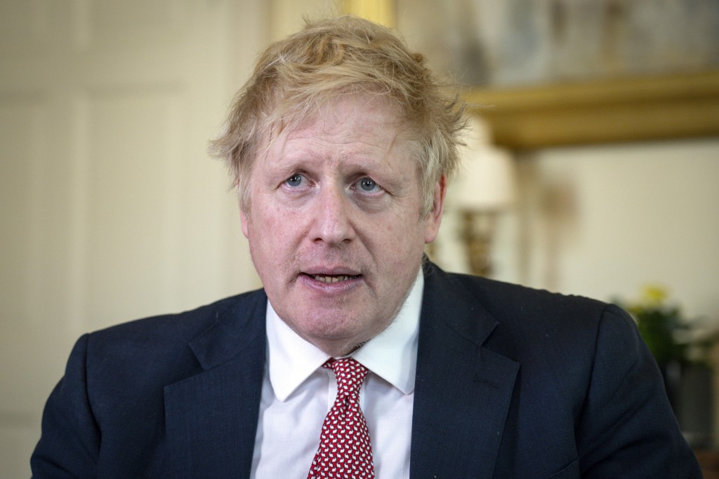 FILE - In this April 12, 2020, file photo issued by 10 Downing Street, Britain's Prime Minister Boris Johnson speaks from 10 Downing Street praising N...