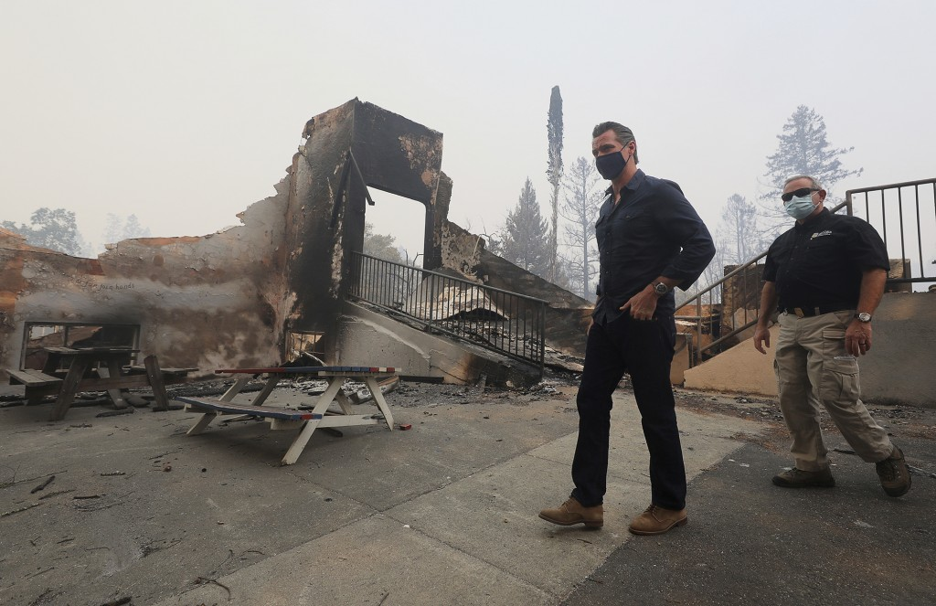 California Governor Gavin Newsom arrives at Foothills Elementary School while touring areas damaged by the Glass Fire near St. Helena, Calif., Thursda...