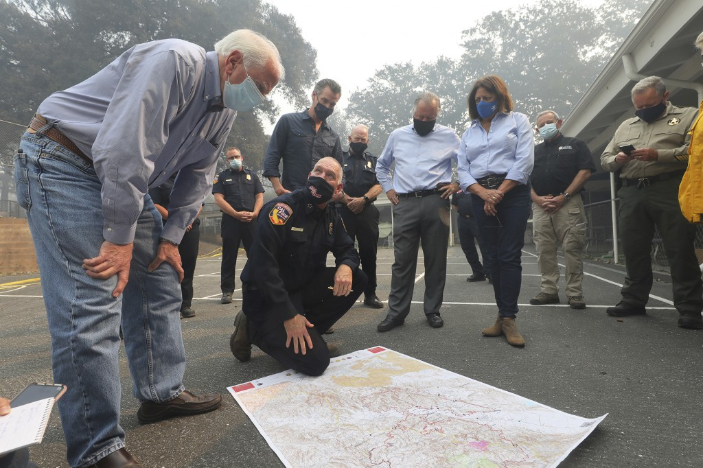 Representative Mike Thompson, left, listens to director of Cal Fire Thom Porter talk about the Glass Fire with Governor Gavin Newsom, Senator Bill Dod...