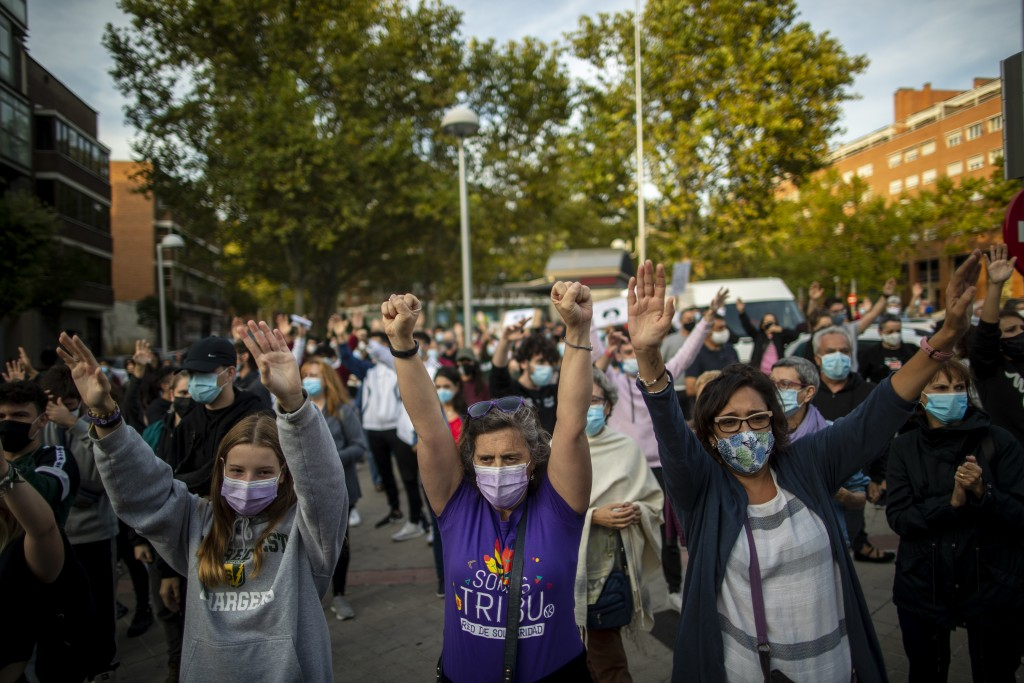 People take part in a protest to demand more resources for public health system and against social inequality in the southern neighbourhood of Valleca...