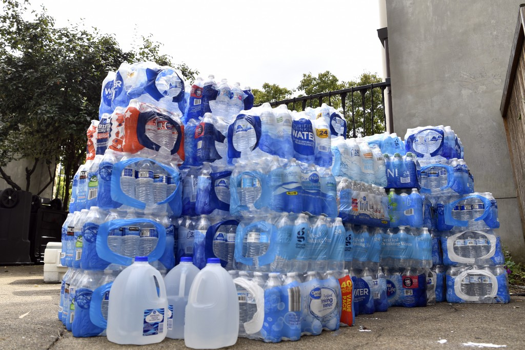 Supplies of water are stacked up in the courtyard of the First Unitarian Church in Louisville, Ky., Tuesday, Sept. 29, 2020. The church has played a b...