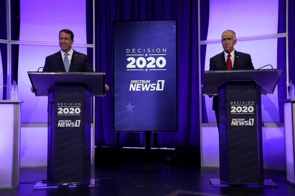 Democratic challenger Cal Cunningham, left, and U.S. Sen. Thom Tillis, R-N.C. wait for the start of a televised debate Thursday, Oct. 1, 2020 in Ralei...