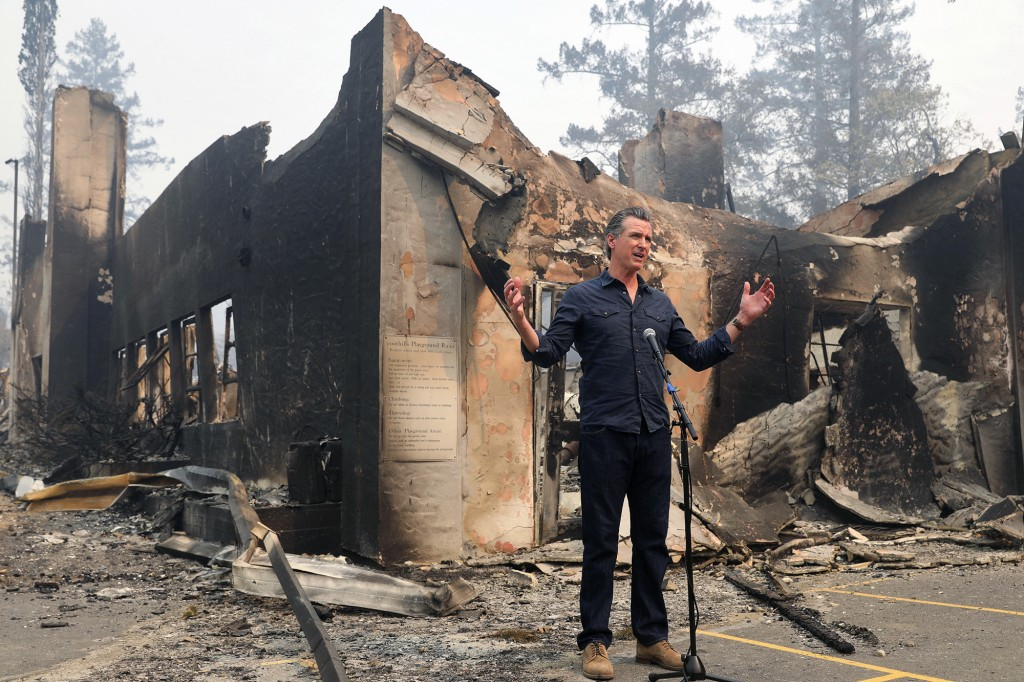 California Governor Gavin Newsom speaks at a press conference while touring areas damaged by the Glass Fire at Foothills Elementary School near St. He...