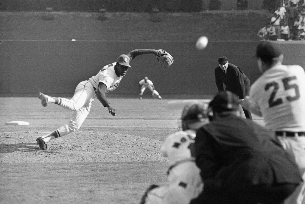FILE - In this Oct. 2, 1968, file photo, St. Louis Cardinals ace pitcher Bob Gibson throws to Detroit Tigers' Norm Cash during the ninth inning of Gam...