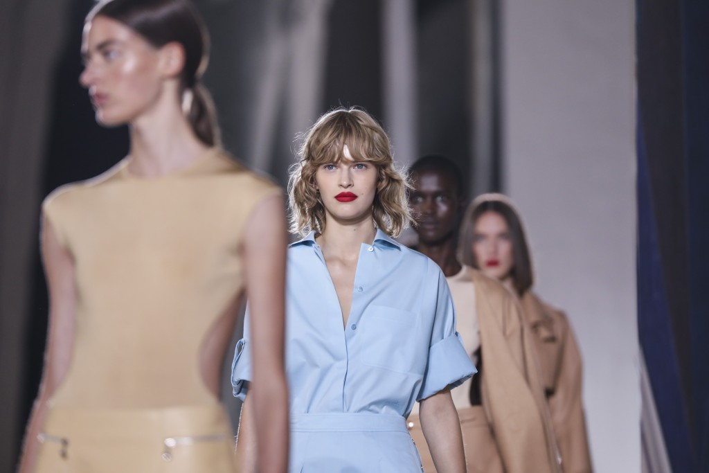 Models wear creations for the Hermes Spring-Summer 2021 fashion collection, Saturday, Oct. 3, 2020, during Paris fashion week. (Photo by Vianney Le Ca...