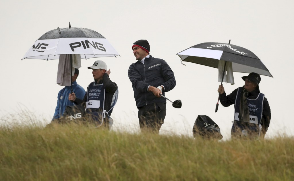 Italy's Edoardo Molinari plays off the 11th tee during the third round of the Scottish Open at The Renaissance Club, North Berwick, Scotland, Saturday...