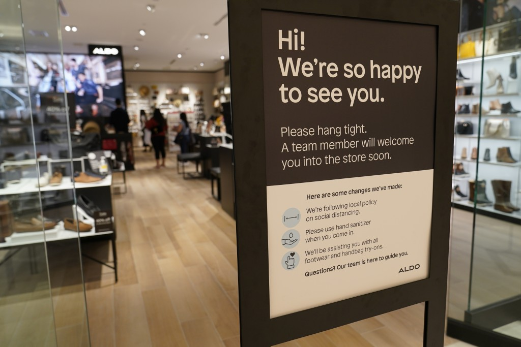 A sign advises customers that they must wait for an employee to escort them into the shoe store at Aldo inside American Dream Mall, Thursday, Oct. 1, ...