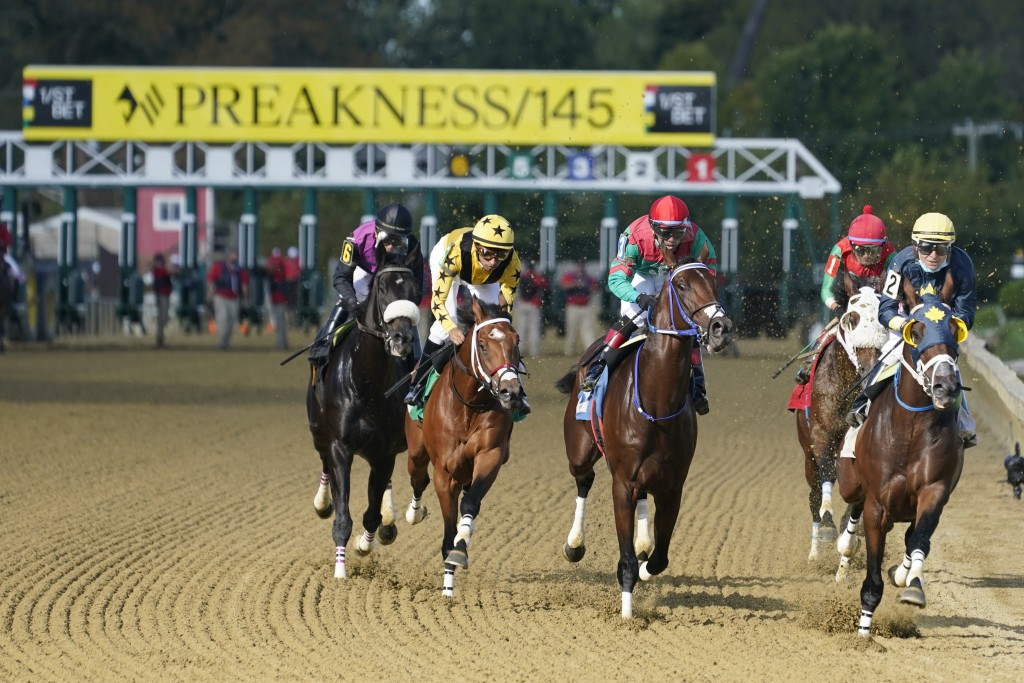 The field heads to the first turn during a horse race at Pimlico race track Friday, Oct. 2, 2020, in Baltimore, Md., ahead Saturday's Black-Eyed Susan...