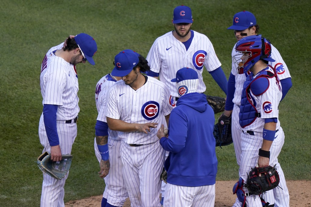 Chicago Cubs' Yu Darvish is removed by manager David Ross during the seventh inning in Game 2 of a National League wild-card baseball series Friday, O...