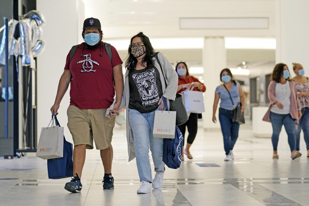 Mask-wearing shoppers make their way down a concourse at the American Dream Mall, Thursday, Oct. 1, 2020, in East Rutherford, New Jersey, after the me...