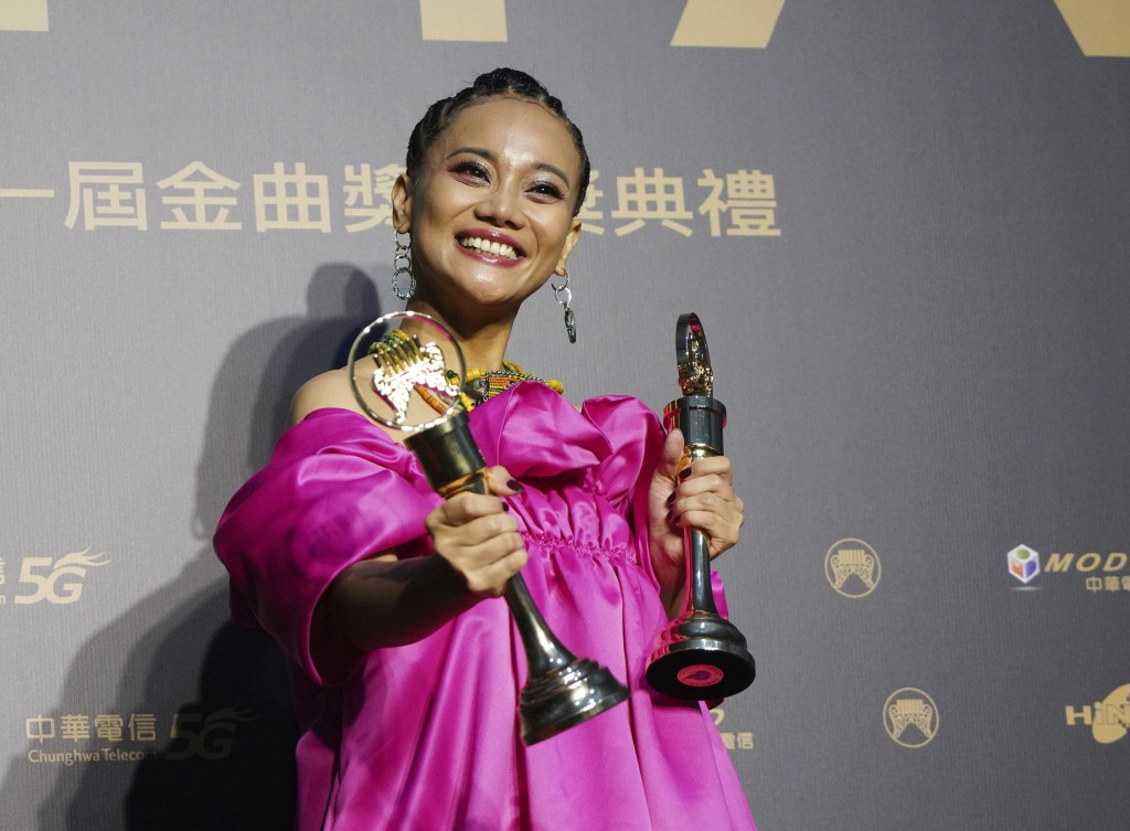 Taiwanese singer Abao holds her awards for Song of the Year and Best Aboriginal Album at the 31th Golden Melody Awards in Taipei, Taiwan, Saturday, Oc...