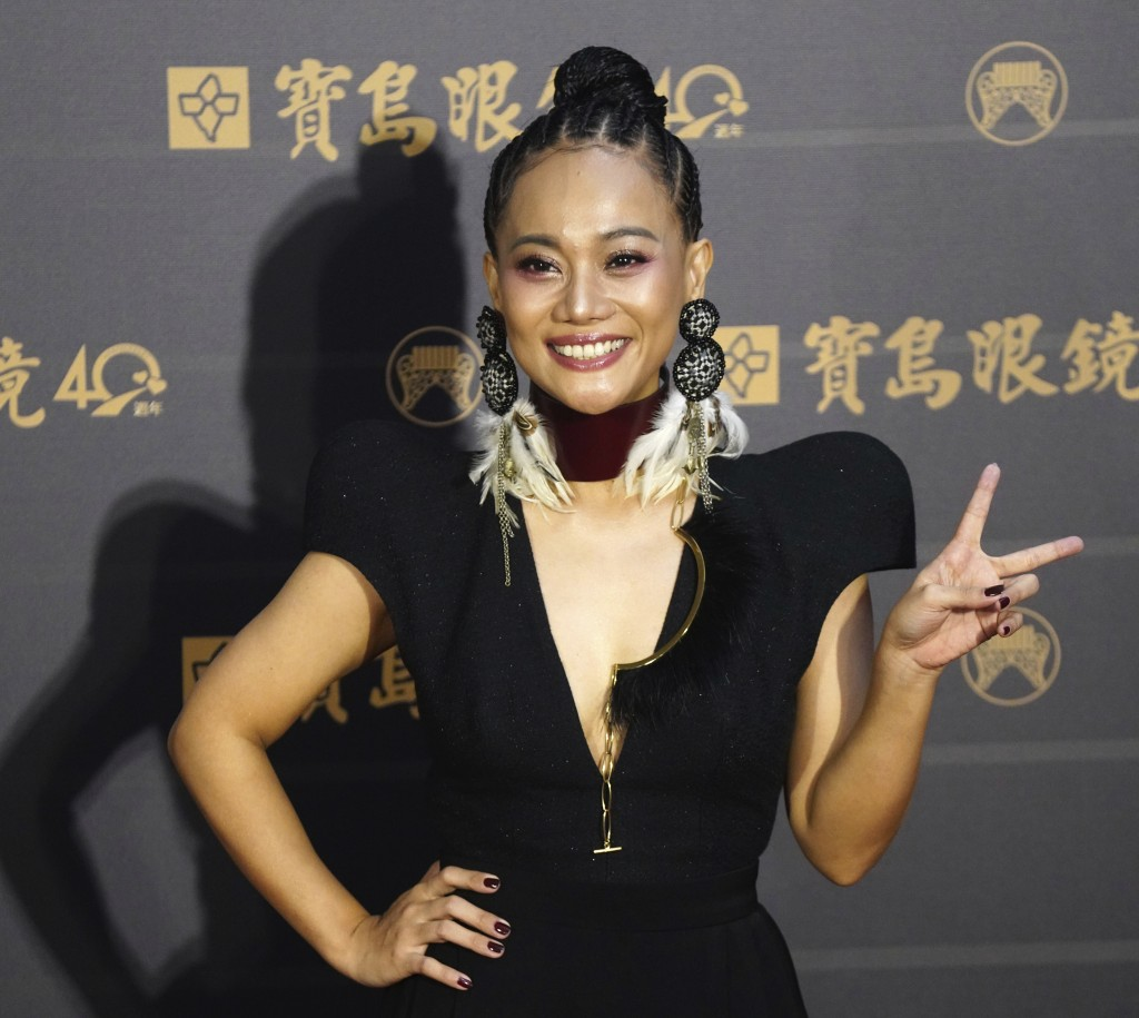Taiwanese singer Abao poses as she arrives at the 31th Golden Melody Awards in Taipei, Taiwan, Saturday, Oct. 3, 2020. The awards show, one of the wor...