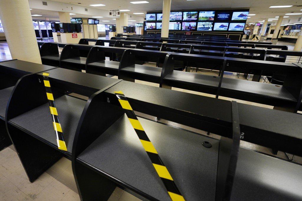 Betting tables are empty at Pimlico race track, Friday, Oct. 2, 2020, in Baltimore, Md., ahead Saturday's Black-Eyed Susan and Preakness Stakes races....