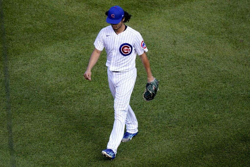 Chicago Cubs starting pitcher Yu Darvish walks off the field after being removed during the seventh inning in Game 2 of a National League wild-card ba...