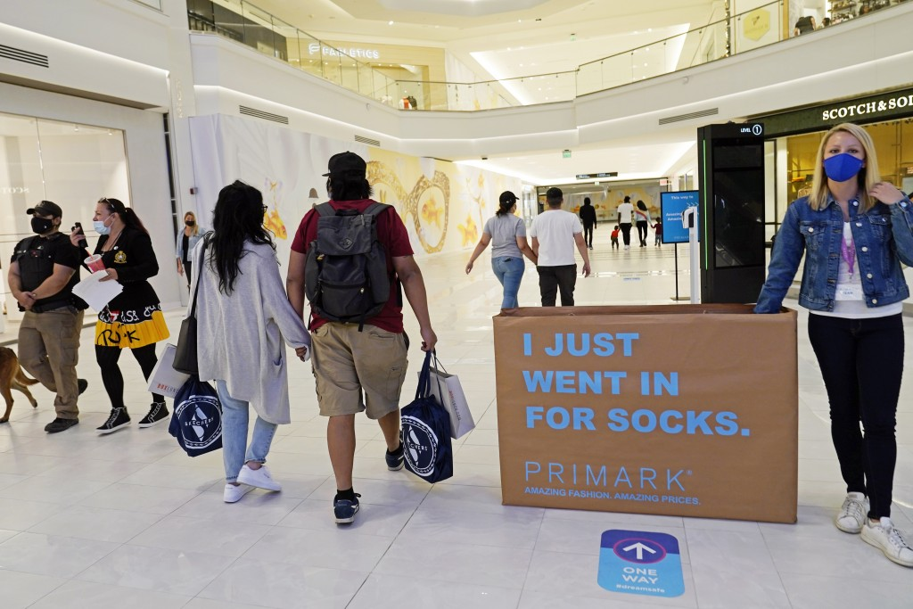 Shoppers and pedestrians walk through a shopping concourse at the American Dream Mall, Thursday, Oct. 1, 2020, in East Rutherford, New Jersey. The meg...