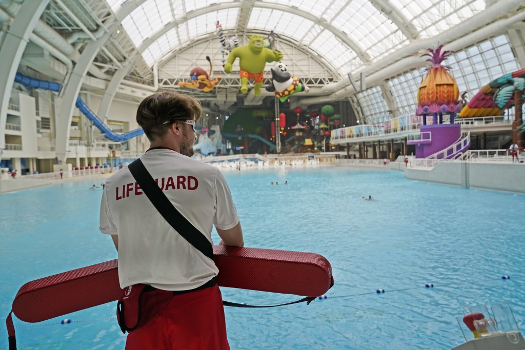 A lifeguard keeps watch over a gigantic pool at the Dreamworks Water Park inside the American Dream Mall, Thursday, Oct. 1, 2020, in East Rutherford, ...
