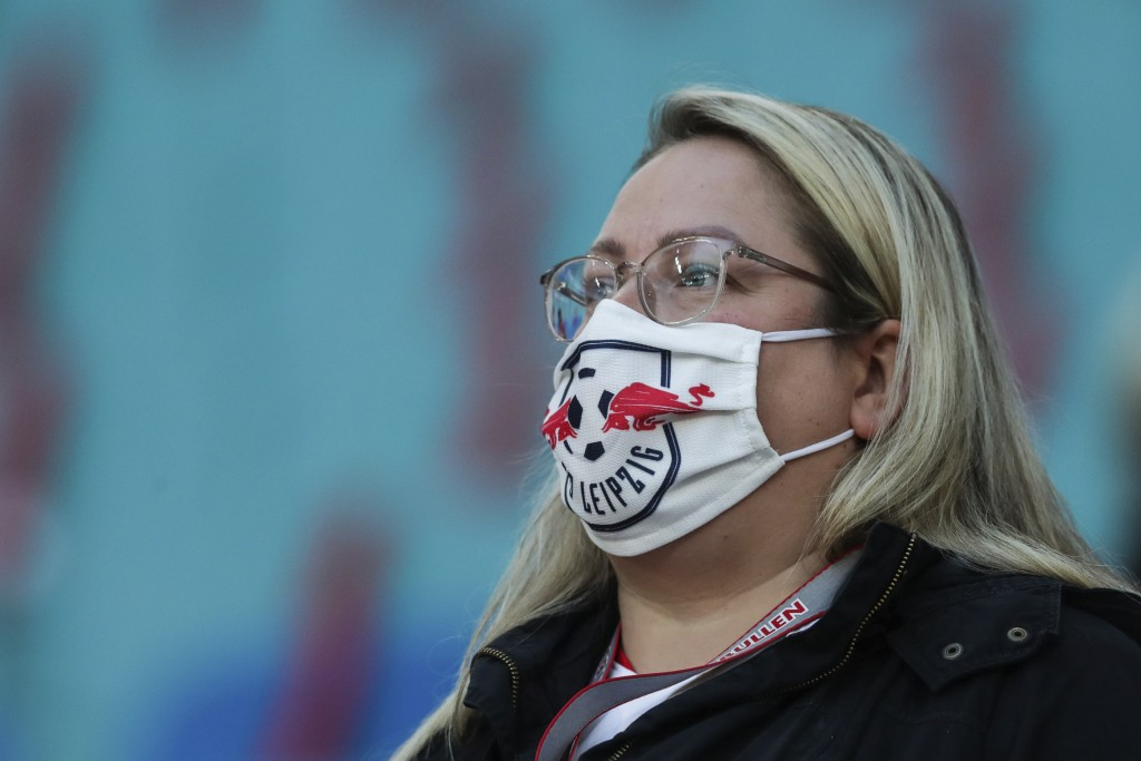 A Leipzig supporter wears a face mask to prevent the spread of the coronavirus prior the German Bundesliga soccer match between RB Leipzig and FC Scha...