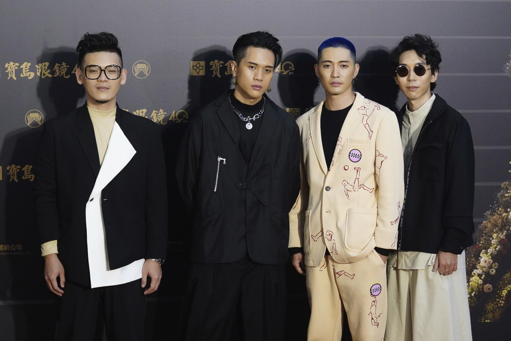 Taiwanese pop group Sugarcat pose as they arrive for the 31th Golden Melody Awards in Taipei, Taiwan, Saturday, Oct. 3, 2020. The awards show, one of ...