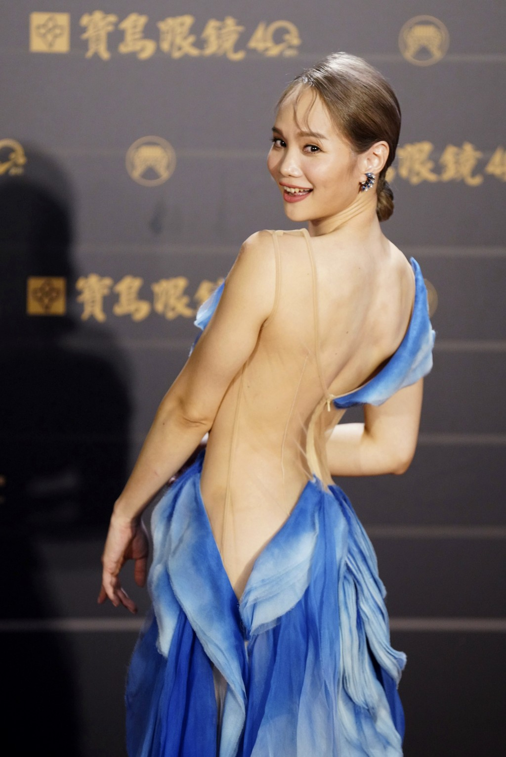 Taiwanese singer Freda Li of pop group ''Murmurshow'' poses as she arrives for the 31th Golden Melody Awards in Taipei, Taiwan, Saturday, Oct. 3, 2020...