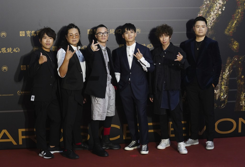 Taiwanese pop group ZenKwun pose as they arrive for the 31th Golden Melody Awards in Taipei, Taiwan, Saturday, Oct. 3, 2020. The awards show, one of t...