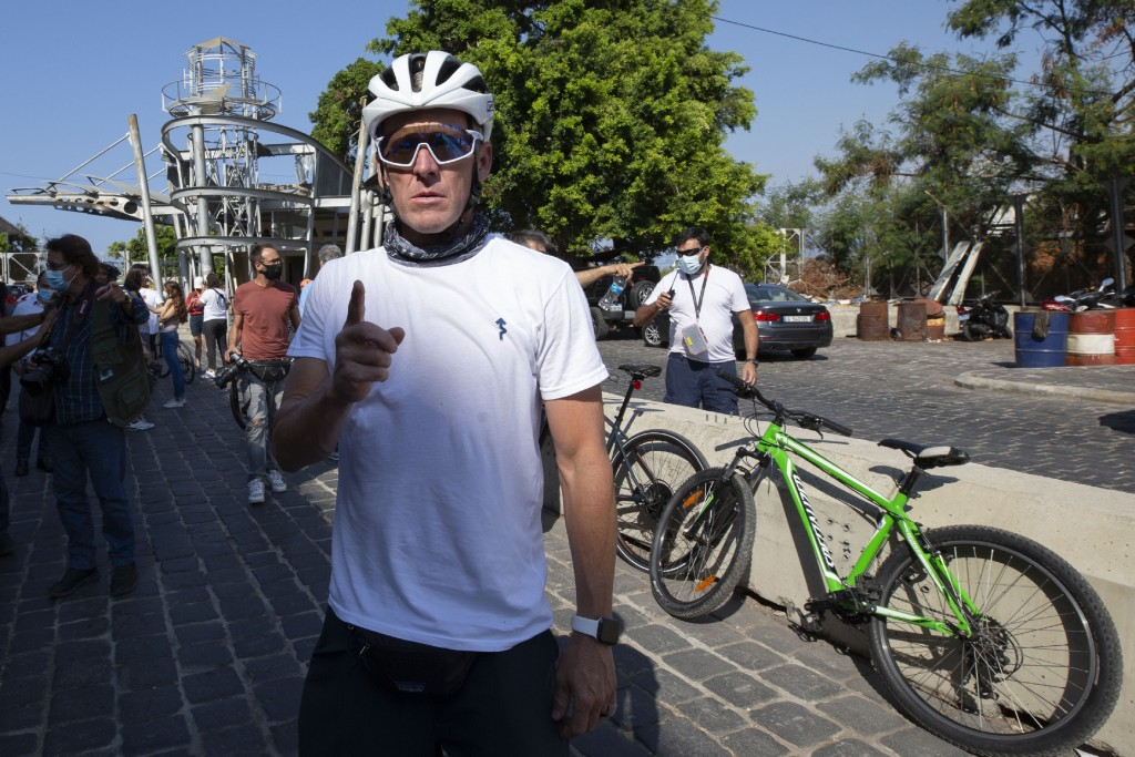 Former American professional cyclist Lance Armstrong, center, prepares to ride with Lebanese and foreign cyclists at the site of the Aug. 4 deadly bla...