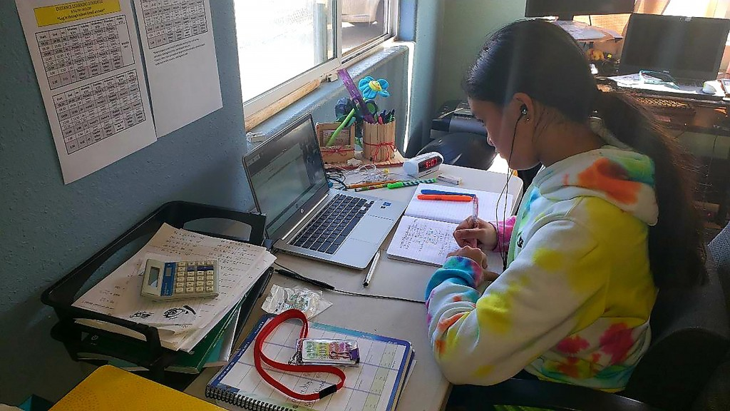 This photo provided by Charles Timtim shows his daughter, name withheld by parents, doing schoolwork from home in Waipahu, Hawaii, Tuesday, Sept. 22, ...