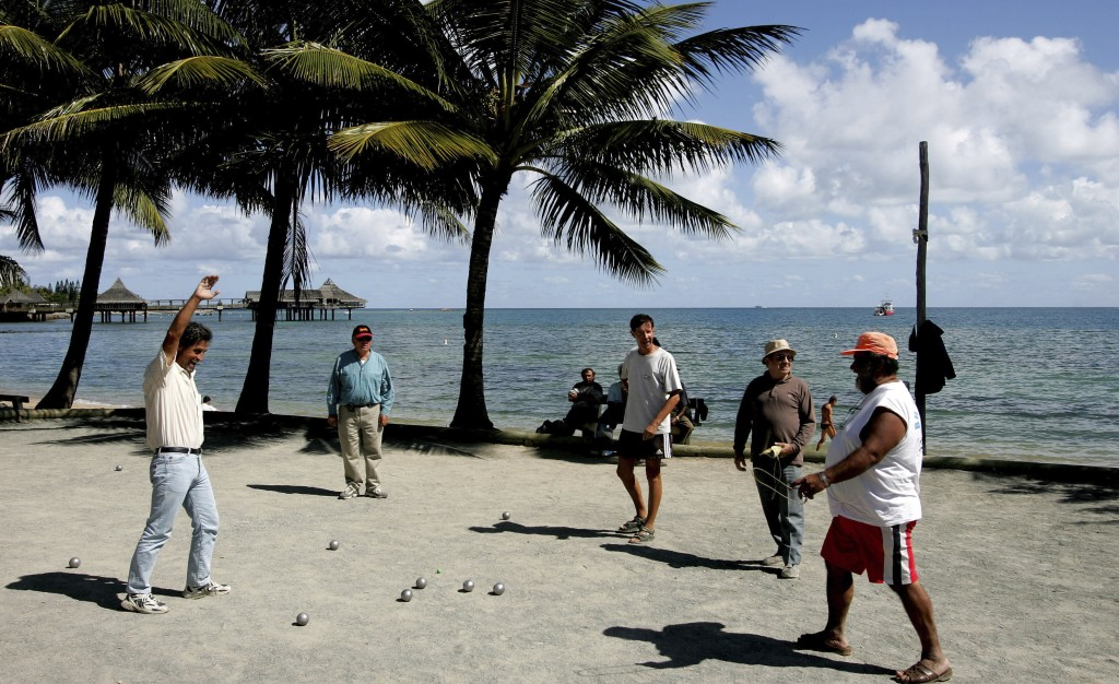 "FILE - In this Thursday, Sept. 22, 2005 file photo, locals on the beach in Noumea, New Caledonia, play the traditional ball game ""petanque"". Voters in..."